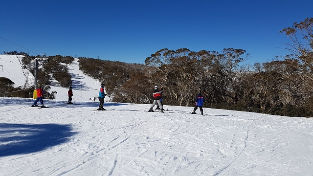 PRISTINE SNOW FIELDS AT MT SELWYN SKI RESORT a group of guests from Boutique Motel Sefton House with owner Tane, enjoy the snow during an escorted group tour.