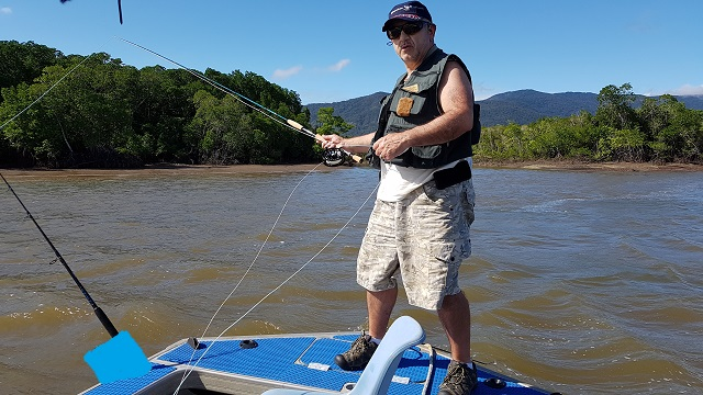 Tane from Tumut Fly Fishing casting a large streamer on Trinity Inlet Cairns in the top end of Queensland, Fly Fishing for Barramundi with a group of clients